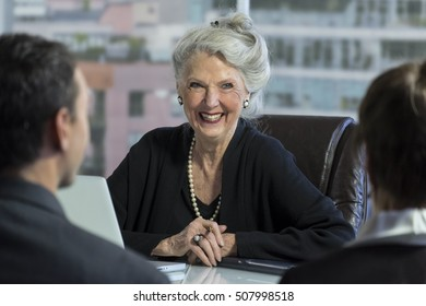 Female senior executive consulting with colleagues