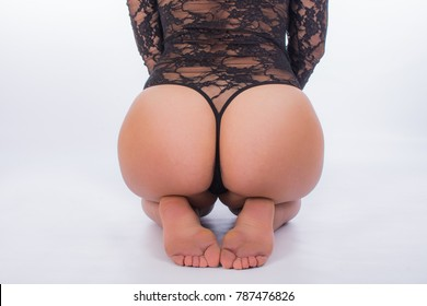 Female with sexy black underwear bent on her knees