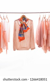 female shirt and sundress clothes,jacket,sweater, scarf, on hanger
