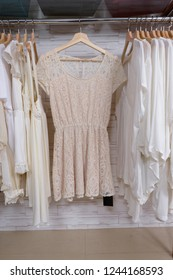 female shirt ,sweater, and,pink clothes, ,sundress,on hanger in clothing store