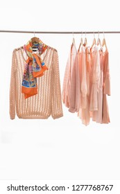 female shirt ,sweater, and scarf ,pink clothes, vest ,sundress,on hanger