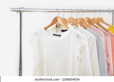 female shirt ,sweater, and sundress ,pink clothes, on hanger