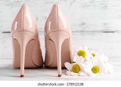 White shoes and flowers images stock photos vectors shutterstock female shoes with flowers on wooden background mightylinksfo