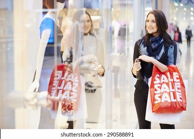 Female Shopper With Sale Bags In Shopping Mall