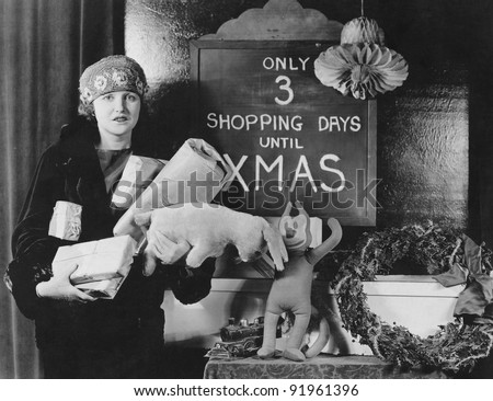 Female shopper and sign with number of shopping days until Christmas