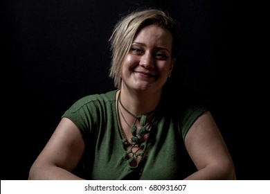Female with short undercut hair smiling to camera