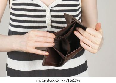 Female showing empty wallet turned upside down