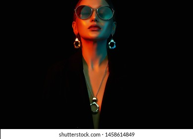 Female silhouette, beautiful woman in color lights. Art design, colorful girl with radiance skin