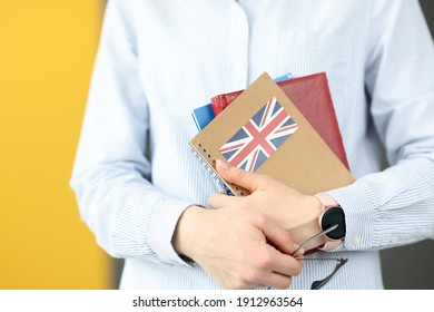 Female silhouette holding diaries with British flag. Self-study foreign languages concept