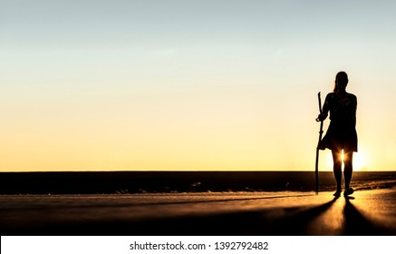 Female silhouette Woman with pilgrim's stick