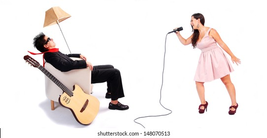 A female singer and a male guitarist in action in white background. The musician is blown away by the powerful voice of the singer