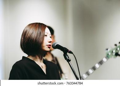 Female singer singing on stage