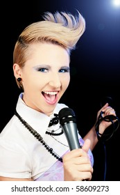 Female singer with special hair cut
