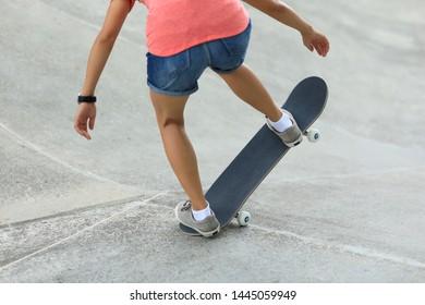 Female skateboarder skateboarding at skatepark