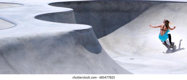 A female skateboarder in Venice Beach, California