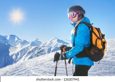 Female skier with beautiful mountain panorama