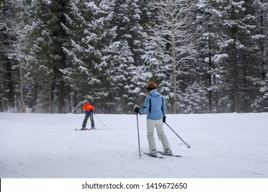 Female skier in blue jacket in snow at Jackson Hole