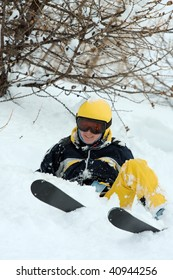 Female skier coming down a wild slope with deep snow