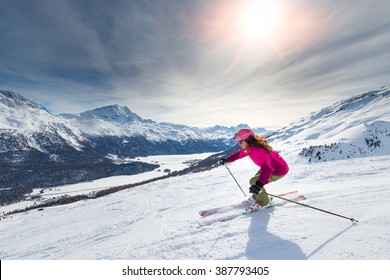 Female skier in downhill slope