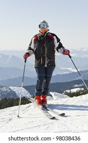 Female skier on the mountain top on a sunny day
