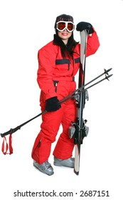 Female skier wearing a red ski suit and carryng matching skis and poles.