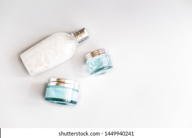 Female skin and body care cosmetic products set flatlay. Overhead, minimalism, beauty blogging concept