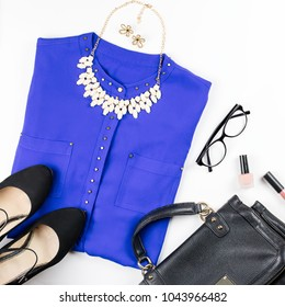Female smart casual style clothing, cosmetics and accessories flat lay.