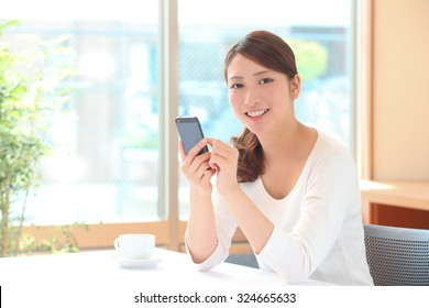 The female with the smart phone