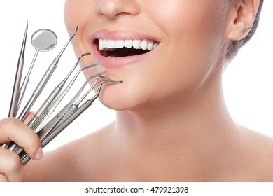 Female smile and detnal tools on white background