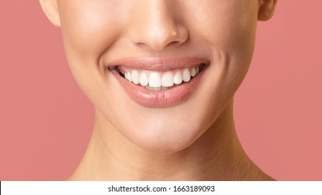Female Smile. Unrecognizable Girl Smiling Showing Perfect White Teeth Posing Over Pink Background. Studio Shot, Cropped