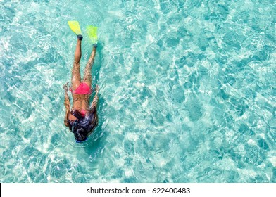 Female snorkeler in turquoise waters