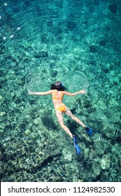 Female snorkeler in turquoise waters of Thailand