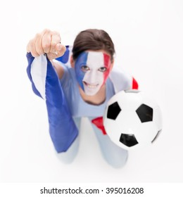 female soccer fan from the national Team of France is cheering, flag and football in the hands