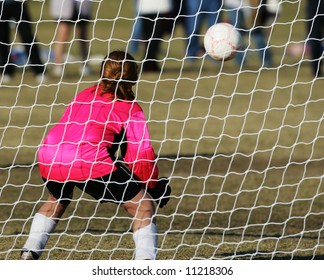 Female Soccer Goalie prepares to stop a goal