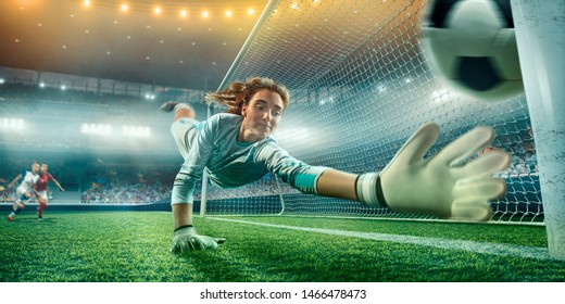 Female Soccer Goalkeeper catch the ball on a professional soccer stadium. Girls playing soccer