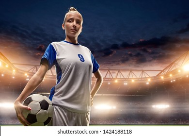 Female Soccer player with ball on a professional soccer stadium