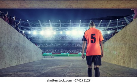 female soccer player entering the field on crowded stadium