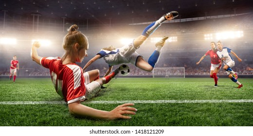 Female Soccer players performs an action play on a professional soccer stadium. Girls playing soccer