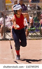 Female Softball Player Drops Bat And Sprints To First Base