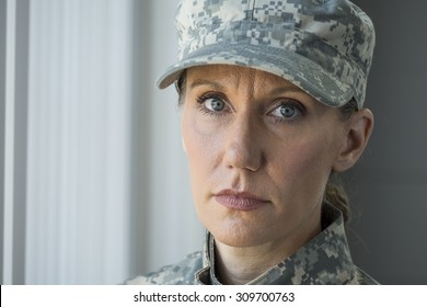 A female soldier looking at camera