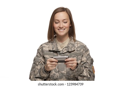 Female Soldier reading text messages
