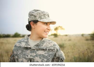 Female soldier smiles in the desert