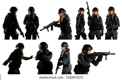 Female soldier in tactical black uniform with rifle. Shot in studio. Isolated with clipping path on white background