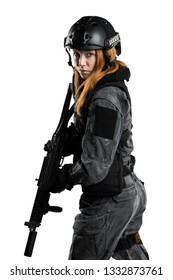 Female soldier in tactical uniform with rifle. Shot in studio. Isolated with clipping path on white background