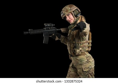 Female soldier in tactical uniform with rifle. Shot in studio. Isolated with clipping path on black background