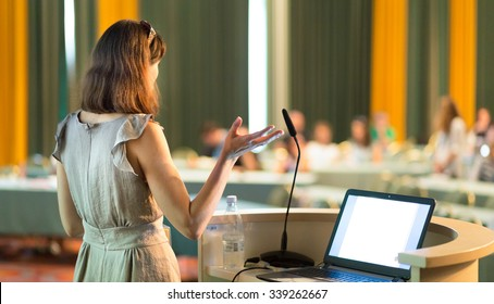 Female speaker at Business Conference and Presentation. Audience at the conference hall. Business and Entrepreneurship. Business woman. Horizontal composition.