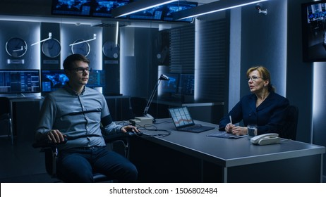 Female Special Agent Conducts Lie Detector Test on a Young Suspect. Corporate Spy Undergoes Polygraph Test, Expert Examiner Questions Accused in Interrogation Room. Computer Records Reactions.