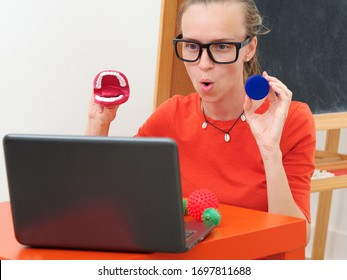 A female speech Therapist conducts an online lesson with a laptop. - Shutterstock ID 1697811688