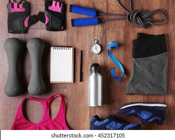 Female sport equipment on a wooden background