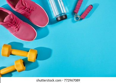 Female sport shoes and equipment top view, copy space. Active lifestyle, body care concept.